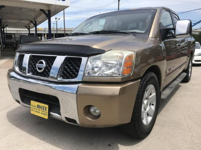 2005 GOLD NISSAN TITAN (1N6BA07A45N) with an V8, 5.6L; FFV engine, located at 5605 Crowley Road, Fort Worth, TX, 76134, (817) 989-9255, 36.148457, -115.048225 - Photo #0