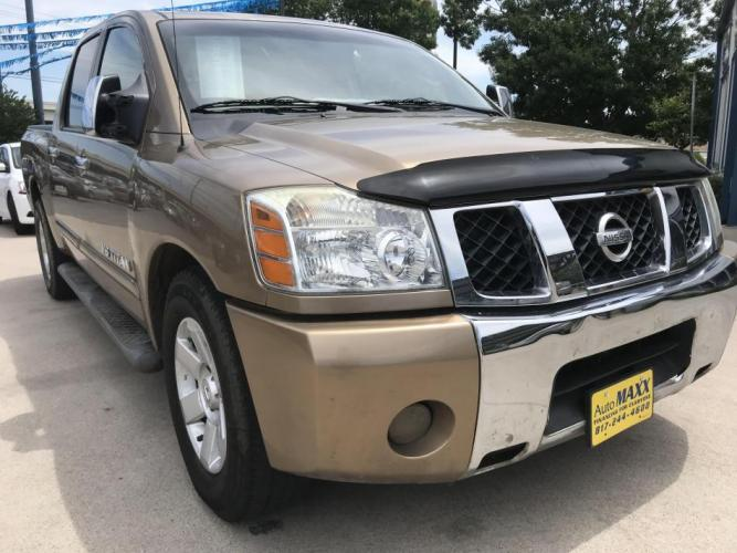 2005 GOLD NISSAN TITAN (1N6BA07A45N) with an V8, 5.6L; FFV engine, located at 5605 Crowley Road, Fort Worth, TX, 76134, (817) 989-9255, 36.148457, -115.048225 - Photo #2