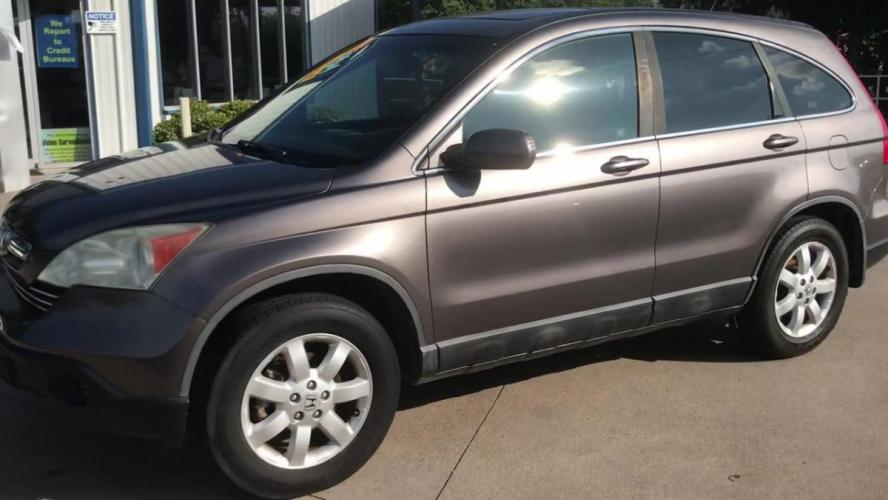 2009 GOLD HONDA CR-V (5J6RE38739L) with an L4, 2.4L engine, 5 SPEED AUTOMATIC transmission, located at 5605 Crowley Road, Fort Worth, TX, 76134, (817) 989-9255, 36.148457, -115.048225 - Photo #5
